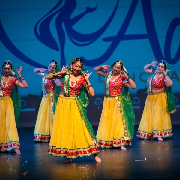 Adaa Dancers in Red and Yellow with Green Accent